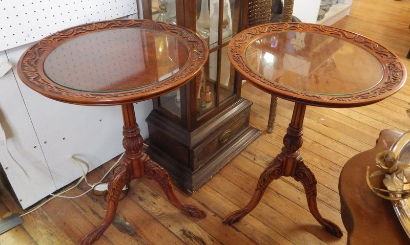 pair of carved round tables